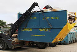 Skip Hire in Brentwood full skip being unloaded